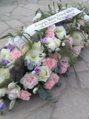 fleurs de deuil dessus de cerceuil rose et blanc fleuriste metz effleurs